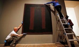 Tate Modern employees rehang Mark Rothko's mural Black on Maroon.