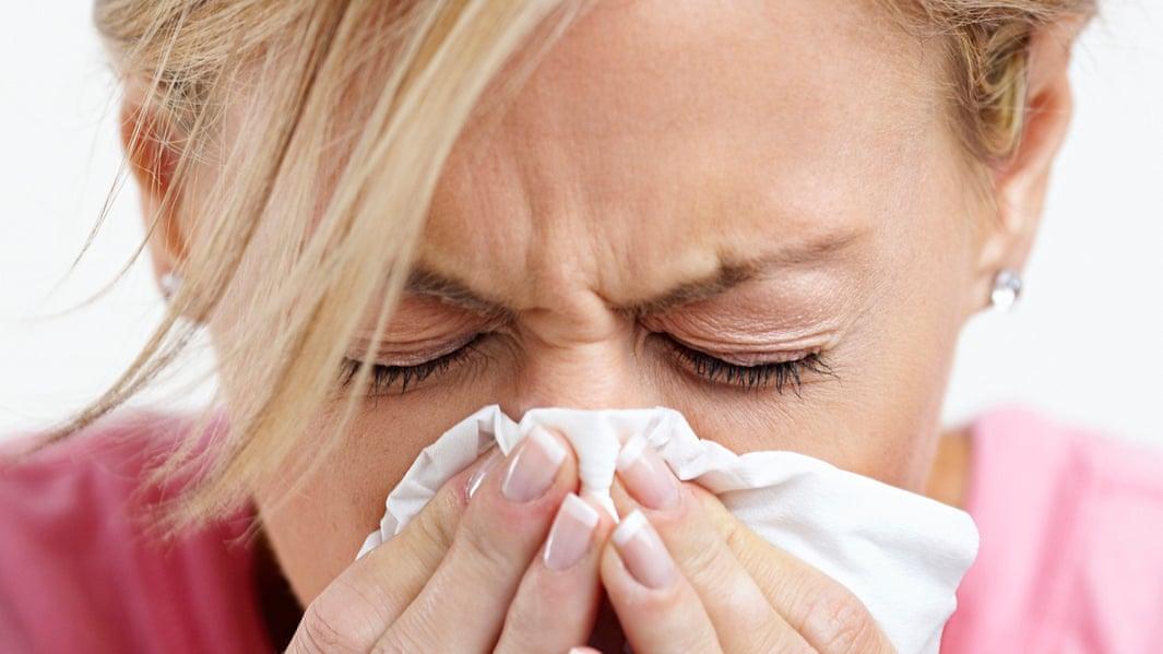 A woman sneezing 004