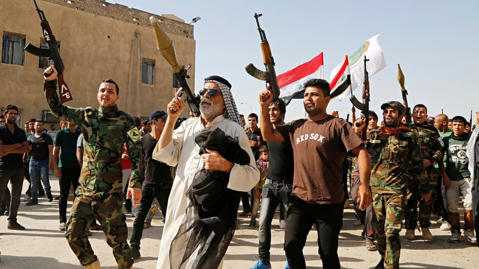 Anti-Isis volunteer fighters in Baghdad's Sadr City