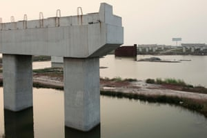 Bridge to nowhere: a six-lane road span was abandoned after 10 support pylons had been erected.