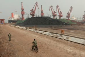 Security guards by Cafofeidian harbour, where coal and iron ore are unloaded to feed the Shougang steel mill – an operation that is mired in debt.
