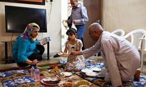Tathamon Abdel Mohsen and her family tuck into the fish delicacy mazgouf before Ramadan begins