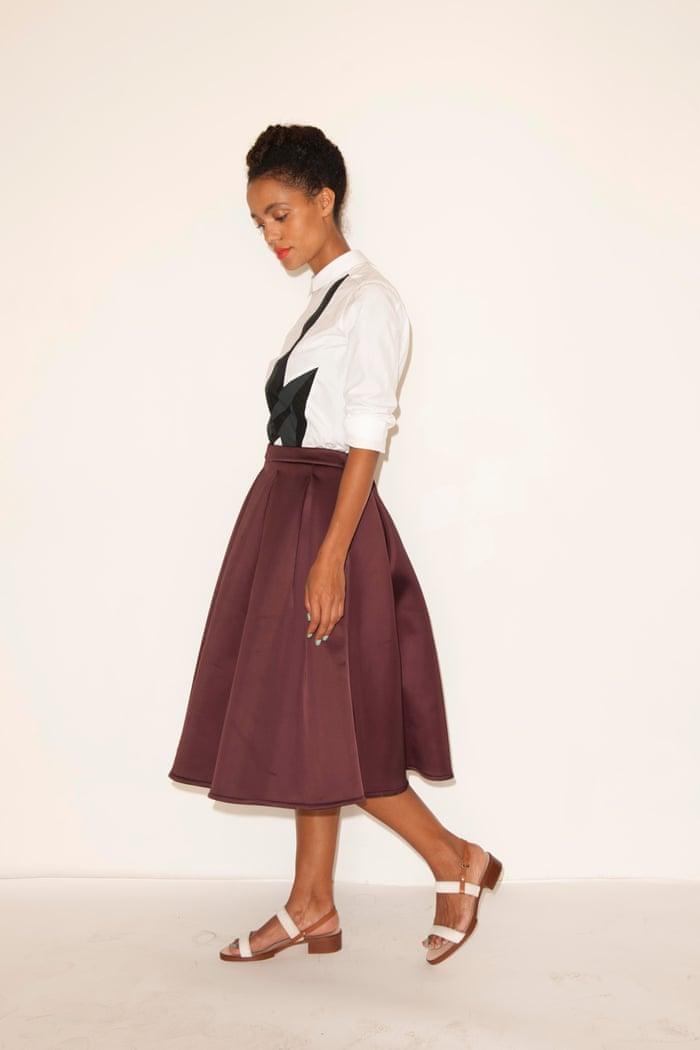 model wearing white shirt maroon skirt white sandals