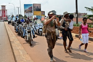 Lev Wood and Boston arrive in Kampala, Uganda,  with a Biker gang entourage.
