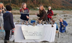 Local girls sell Torr Fisk (dried fish) on the beach. The snack is a local speciality and it takes up to three weeks to dry the fish, which is usually cod. The fish needs to be hammered with a mallet to soften it before eating.