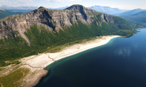 A view of Sandhornøya from the sky. The sparsely populated island in the Nordland region can be reached from the mainland by road - winding through the hills and fjords - or by boat.