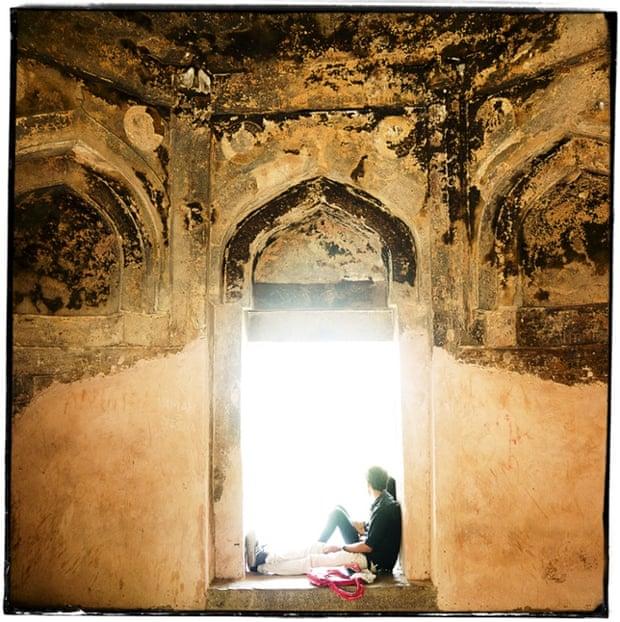 Couple sitting at a window at Hauz Khaz.