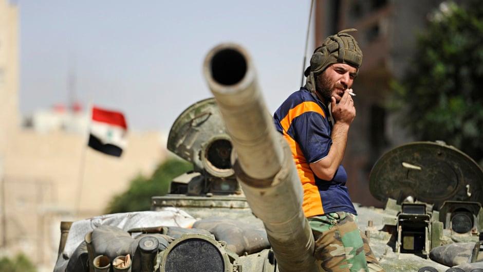 A soldier loyal to Syria's president, Bashar al-Assad