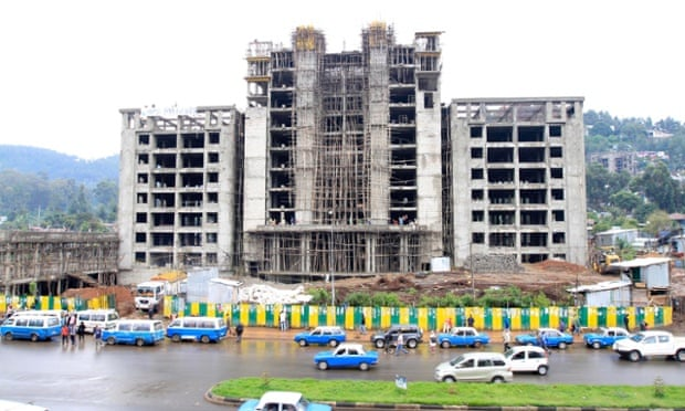 Traffic passes a street with buildings under construction in Addis Ababa