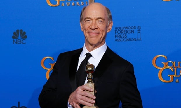 JK Simmons poses with his Golden Globe.
