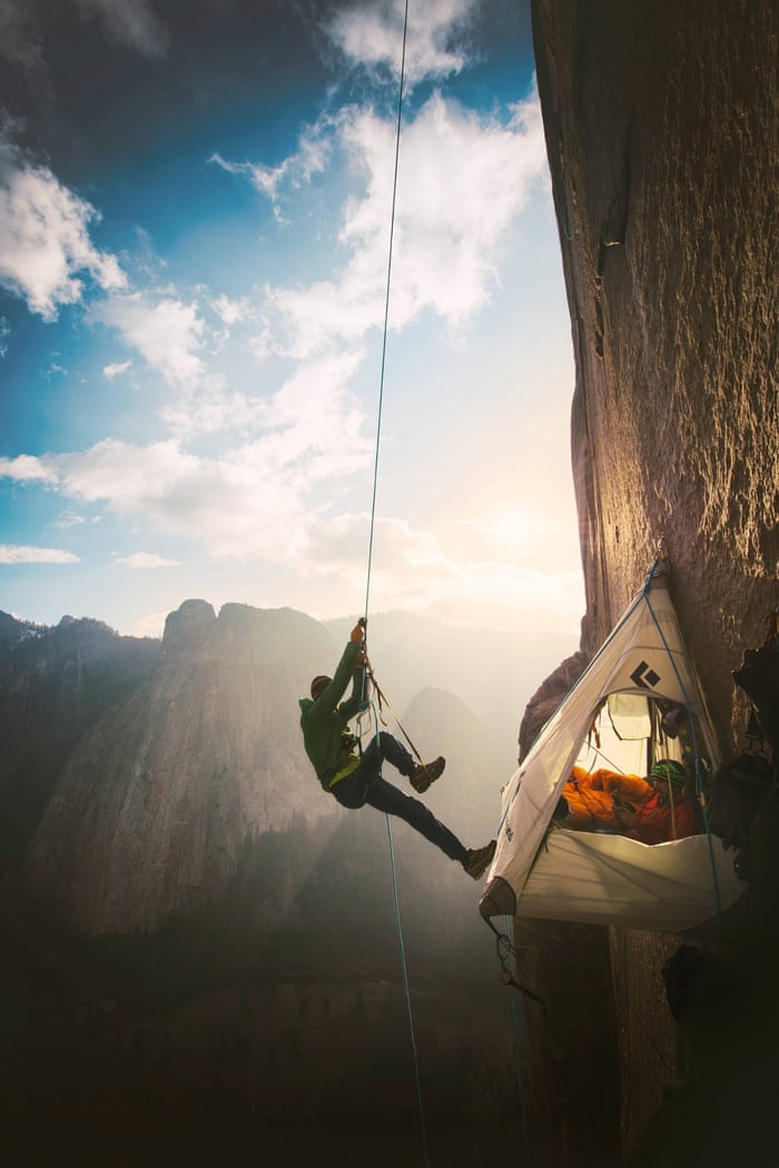 """Two climbers in California's Yosemite national park make history as they reach the summit of what has been called the world's hardest rock climb. Kevin Jorgeson and Tommy Caldwell, seen climbing here, scaled the half-mile section of exposed granite known as the Dawn Wall on El Capitan peak.<a href=""""http://www.theguardian.com/us-news/gallery/2015/jan/15/conquering-el-capitan-climbers-make-history-in-californias-yosemite-national-park-in-pictures""""> See more images of the climb here</a>"""