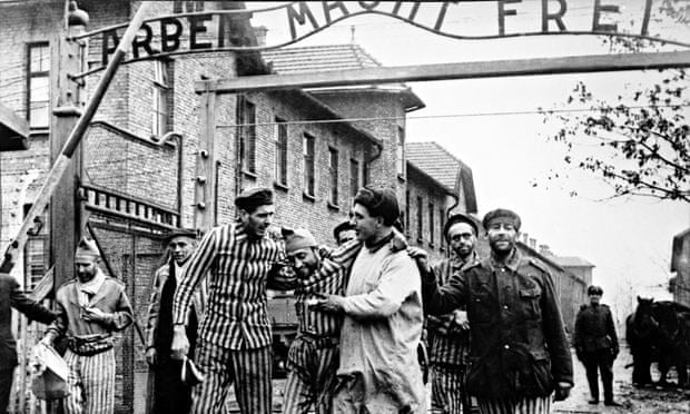 A Red Army doctor with a group of survivors at the gate to Auschwitz, shortly after the camp's liberation in January 1945. Photograph: Heritage Images/Getty Images