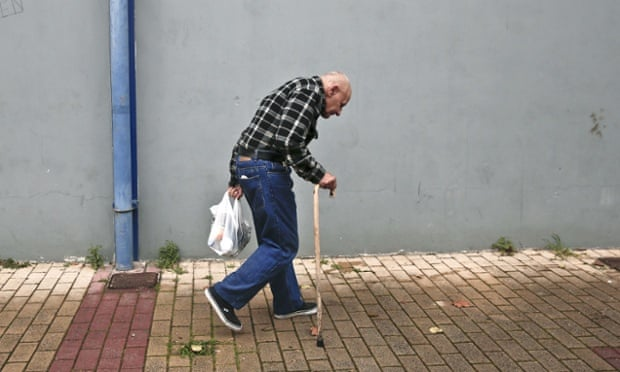 A man holds a bag with food as he leaves a New Year's meal for the homeless in Athens.