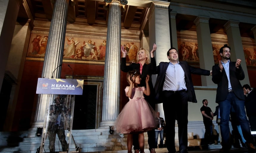 Syriza leader Alexis Tsipras, second right, celebrates success in May's European parliament elections with Athens governor Rena Dourou, left, and mayoral candidate Gabriel Sakellaridis.