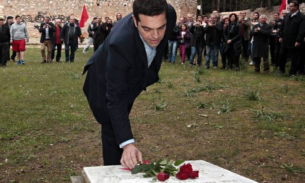 Alexis Tsipras places flowers on the National Resistance Memorial in Kaisariani on Monday.