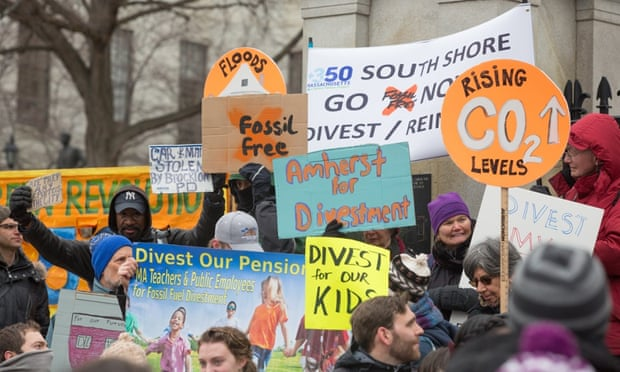 Environmentalists rally in Boston to demand state legislators support a bill that would require divestment from the state's fossil fuel holdings
