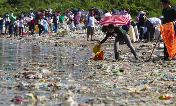 Filipino volunteers pick rubbish during the 29th International Coastal Cleanup at the shore of the 'Long island' in Paranaque city, south of Manila. A new study indicates that the plastic problem might be bigger than we ever thought.