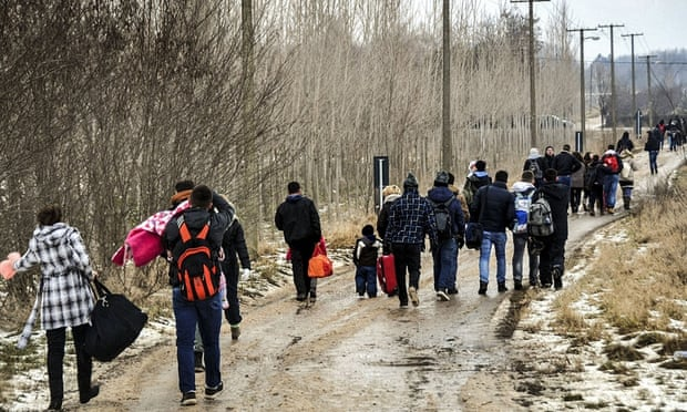 Kosovans in Belgrade, Serbia, head for buses to Subotica, the nearest city to the Hungarian border, to try to enter the EU country.