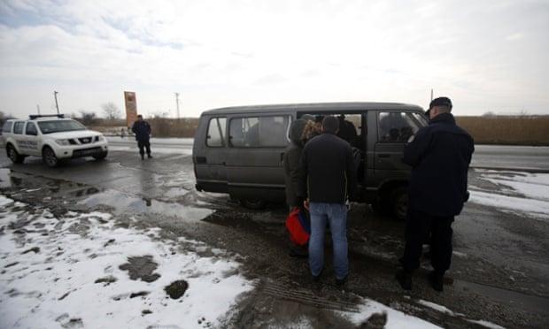 Serbian border police detain Kosovan nationals near Subotica.