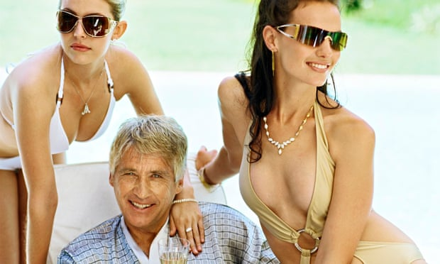 Man with two women in bikinis