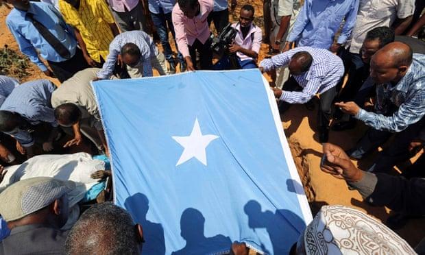 Mourners bury the Somali MP Abdullahi Qayad Bare, who was shot dead in Mogadishu by al-Shabaab gunmen in February.