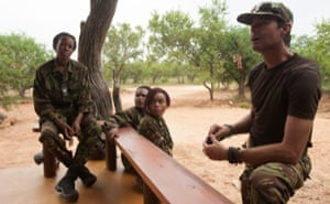 Craig Spencer, right, debriefs the members of the Black Mamba anti poaching unit.