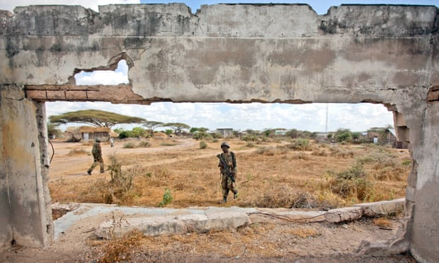Kenyan army soldiers patrol in Tabda, across the border inside Somalia