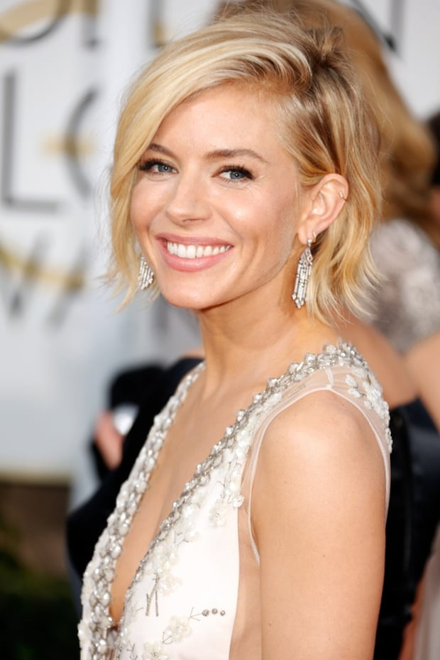 Fabulous earrings ... Sienna Miller at the Golden Globes. Photograph: Jeff Vespa/WireImage