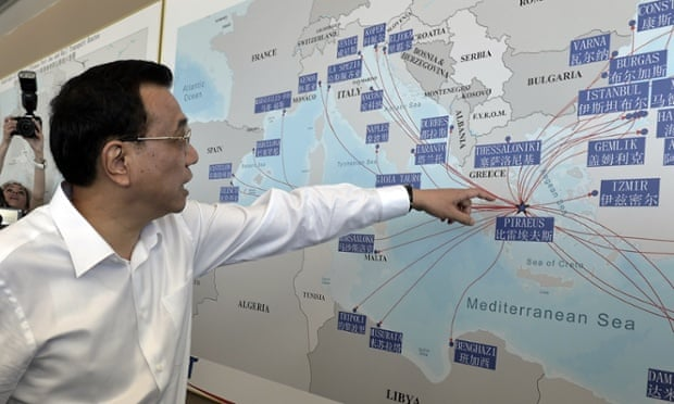 The Chinese premier, Li Keqiang, looks at a shipping routes map at the port of Piraeus, where Chinese shipping giant Cosco controls two of the three container terminals, on a visit last year.