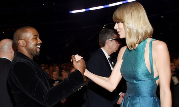 Kanye West greets Taylor Swift at the Grammys last night