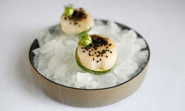 Turning Japanese: raw scallop with miso glaze and sesame seeds.