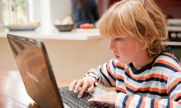 A young boy at a computer