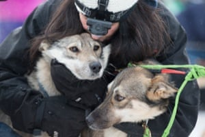 Handler Connie LaRose hugs the sled dogs before the official start