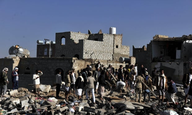 People search for casualties at a bomb site near an air base in Sana'a, Yemen.