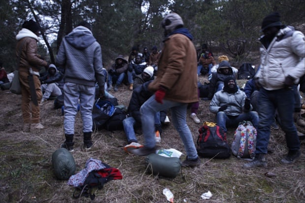 West African migrants prepare at dusk to march through the night near the town of Gevgelija, Macedonia, after crossing the border from Greece.