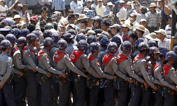 police in helmets block the students in Letpadan, Burma