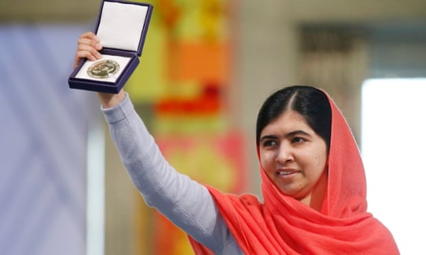 Laureate Malala Yousafzai displays her medal during the awarding ceremony of the 2014 Nobel Peace Prize at Oslo City Hall, Norway.