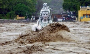 A submerged idol of Hindu Lord Shiva stands in the flooded river Ganges at Rishikesh on June 18, 2013.