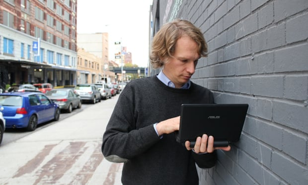 A man uploads information from a USB Dead Drop in New York City.