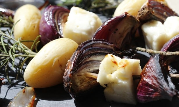 Toasted halloumi, new potatoes and roasted red onion on herby skewers