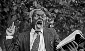 Preacher with Bible, 1993 Photograph: Philip Wolmuth/The History Press