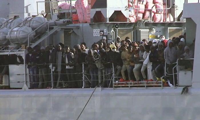 Migrants aboard an Italian navy vessel approaching the Italian port of Messina on Saturday.