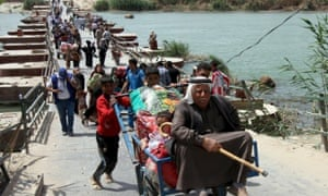 Sunnis flee Ramadi west of Baghdad this month. The Iraqi city is at risk of falling under Isis control.