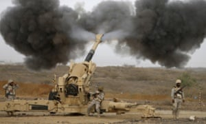 Saudi army artillery fires shells towards Houthi positions from the Saudi border with Yemen.