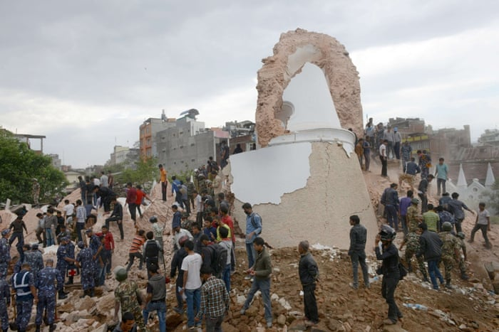 Nepalese rescue workers gather at the collapsed Darahara Tower in Kathmandu