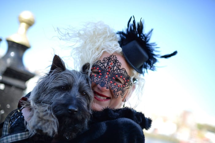 A goth poses for a photograph with her dog in Whitby, North Yorkshire.