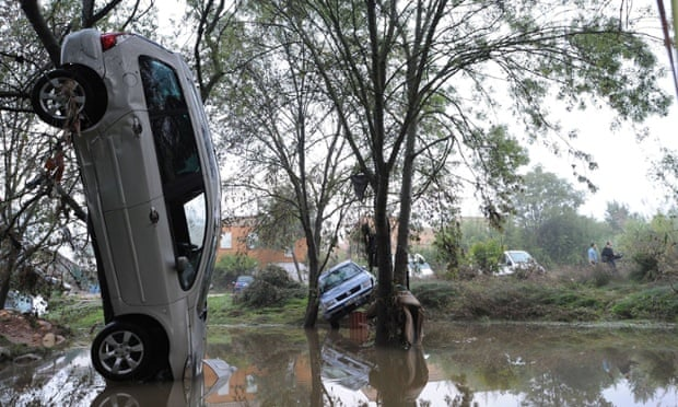 Cars are left stranded among trees following the overnight flash floods in Grabels near Montpellier, France in 2014.