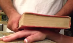 A ganglion cyst about to smashed with a book