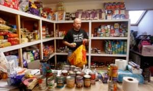 Volunteer William Forey at Drumchapel food bank near Glasgow.
