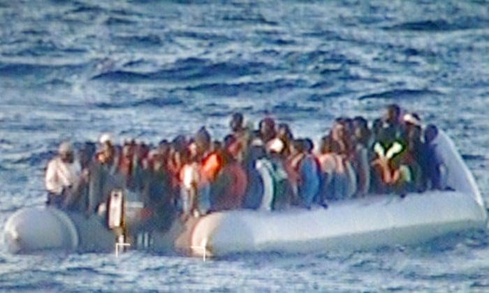 An Italian naval vessel carries people rescued in the Mediterranean in December